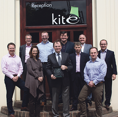 L-R: Paul Mustard, Neil Spears, Marie-Bernadette Ashe, Andy Fay, Bruce McInnes, Chris O'Reilly, Warren Powell, Jake Kirk, Gavin Ashe & Neil Hopkins of Kite Packaging accept the Outstanding Achievement Award