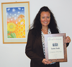 Jan Orrett, Sales & Marketing Manager, accepts the Award from our journalist
